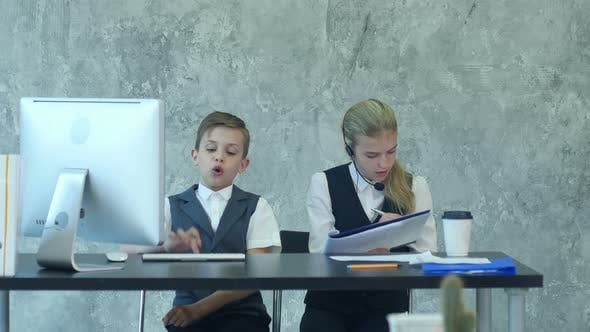 Thumbnail for Little Boy and Cute Girl in Business Suits Working in the Office Together