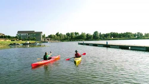 Two kayaks with people on the river