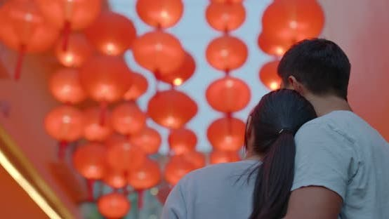 Cover Image for Couple look the the red lantern at outdoor in the evening