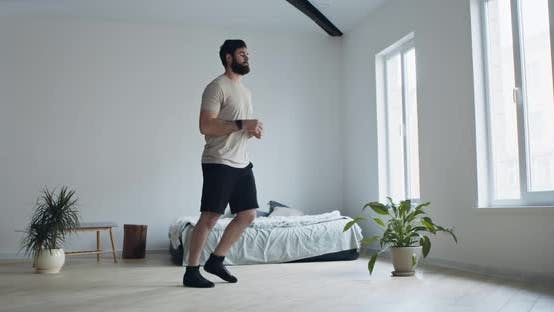 Thumbnail for Young Man Doing Forward Lunge Exercises at Home