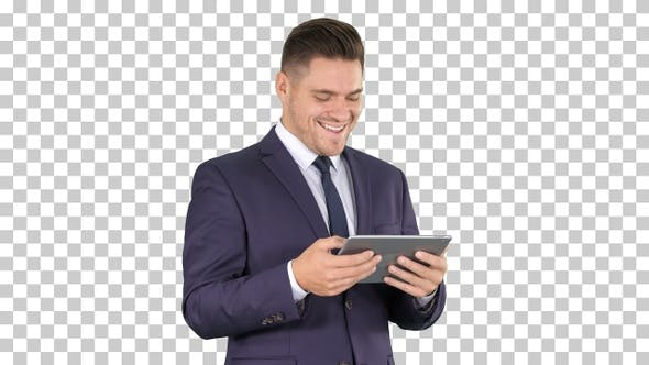 Thumbnail for Businessman Reading or Working on A Digital Tablet, Alpha Channel