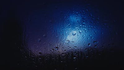 Raindrops On Glass. Thunderstorm In Background