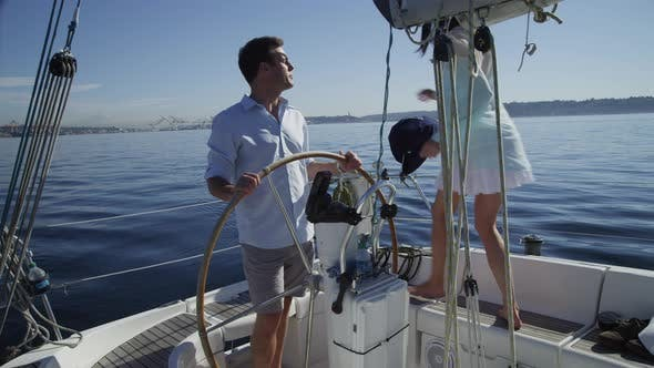 Thumbnail for Young couple on sailboat together. Shot on RED EPIC for high quality 4K, UHD, Ultra HD resolution.
