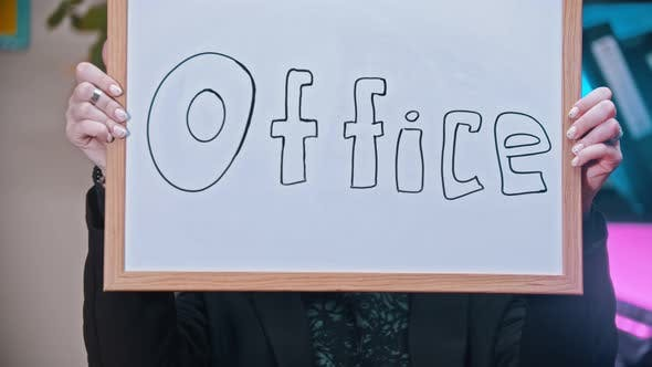 Thumbnail for A Business Woman Putting Out a Nameplate with OFFICE Sign
