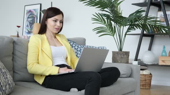 Thumbnail for Online Video Chat by Woman Sitting on Sofa at Home