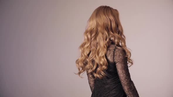 Thumbnail for Blonde Pretty Lady in Black Dress Touching Gorgeous Curls