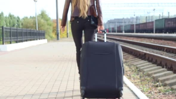 Thumbnail for Girl With A Suitcase Leaves The Railway Platform