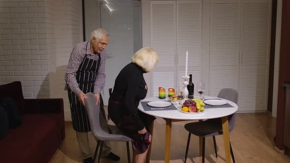 Thumbnail for Senior Retired Couple Having Fun During Romantic Supper in the Kitchen Celebrating Their Anniversary
