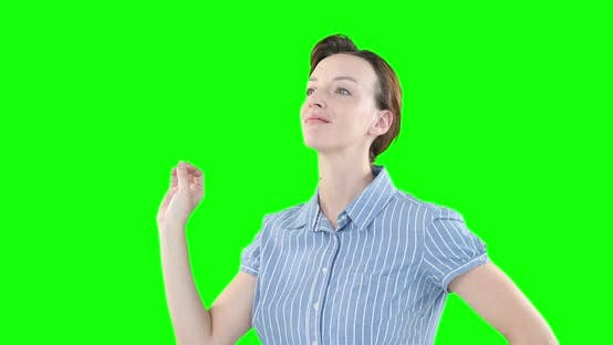 Thumbnail for Caucasian woman raising hand on green background