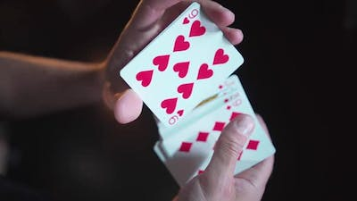 Close-up. Slow motion. Men's hands mix a deck of cards. Gambling Top view