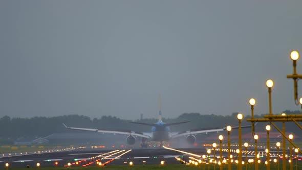 Airplane Landing at Amsterdam Airport