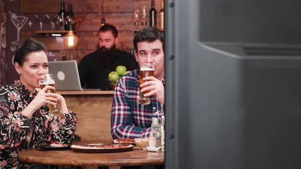 Thumbnail for Watching TV in Pub