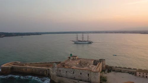 A Bird's Eye View of Ortigia Island at Sunset, Sailing Ship Out of the Bay, Sicily
