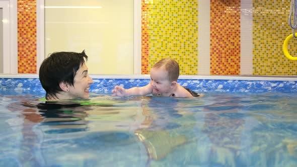 Coach Teaches Girl in Pool