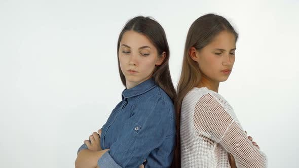 Thumbnail for Two Female Friends Standing Back To Back Looking Angry After Having a Fight