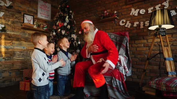 Thumbnail for Three Young Boys Tell Santa Claus Funny Stories in Decorated in Festive Room