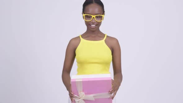 Thumbnail for Happy Young Beautiful African Woman Giving Gift Box