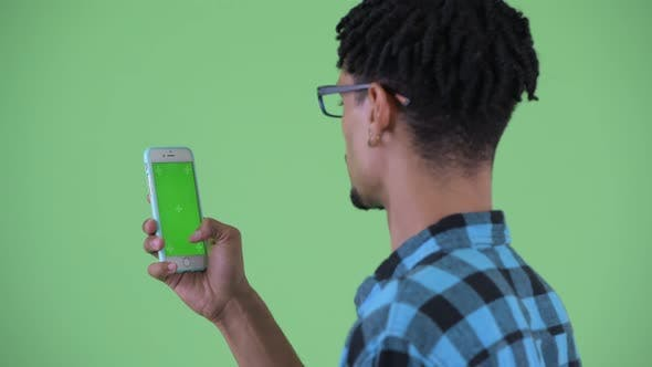 Thumbnail for Closeup Rear View of Happy Young African Hipster Man Using Phone