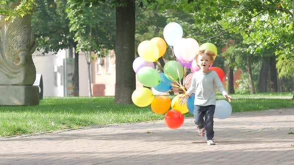 Thumbnail for Emotional Little Girl Runs with Multicolored Balloons, Slow Motion