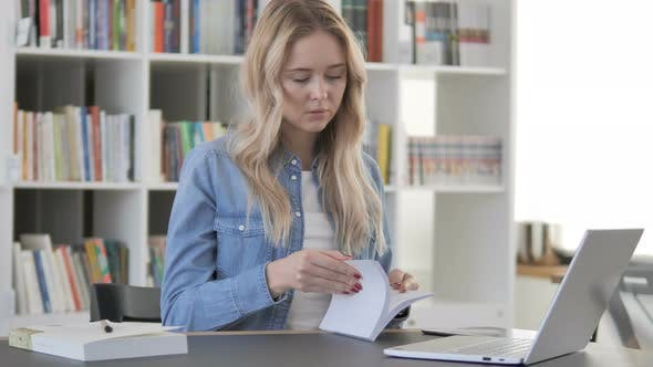 Thumbnail for Young Woman Reading Book in Library
