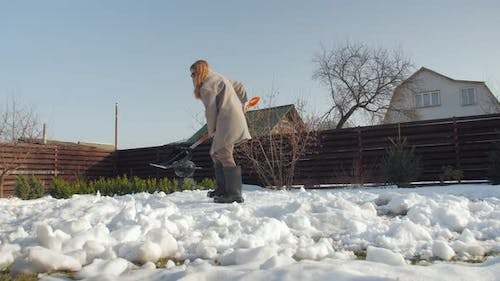 Clearing Snow In The Backyard