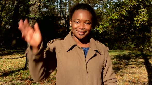 Thumbnail for Young Beautiful Happy African Girl Stare To Camera, Stands in the Woods and Waves To Someone