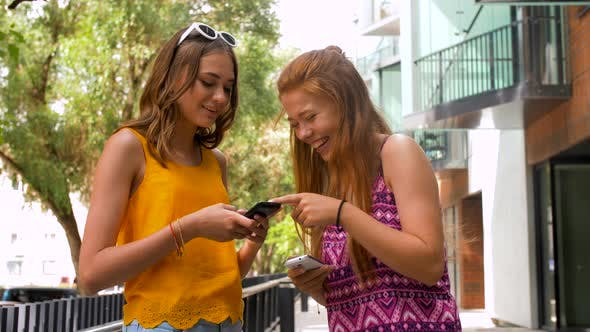 Thumbnail for Teenage Girls with Smartphones in Summer City