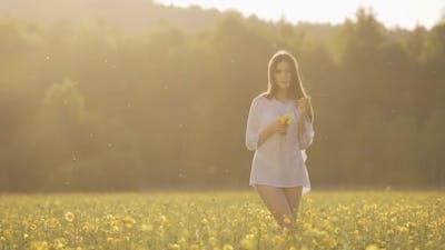 Girl in Yellow Flowers Field