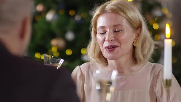 Cover Image for Smiling Caucasian Woman Toasting Husband with Champagne