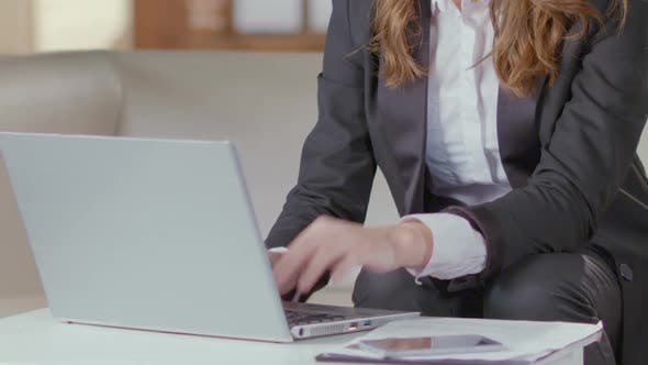 Thumbnail for Woman in Business Suit Working with Laptop, Statistical Report, Company Employee