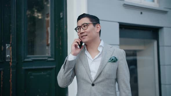 Korean Businessman Ending Successful Phone Call