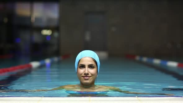 Thumbnail for Woman In The Pool Looking At Camera