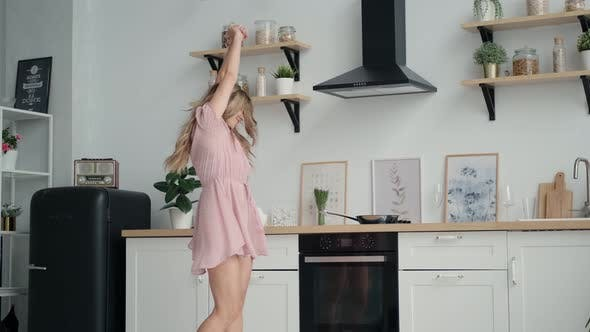 Thumbnail for Happy and Carefree Girl Dancing Funny in the Kitchen