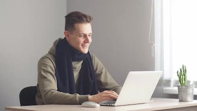 Business Man Talking To Family on Skype