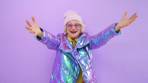 Charming Pensioner Spread Her Arms and Hugged the Camera. a Smiling Woman Happily Poses Against an