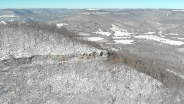 Thumbnail for Aerial of Wilderness Mountain Ridge with Snow