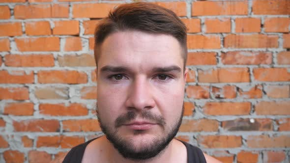 Thumbnail for Portrait of Young Bearded Guy Looking Into Camera with Confident and Serious Expression on His Face