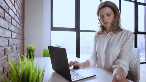 Businesswoman at Modern Workspace