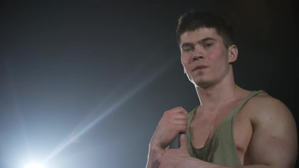 Thumbnail for Face of Male Athlete in Dark Room