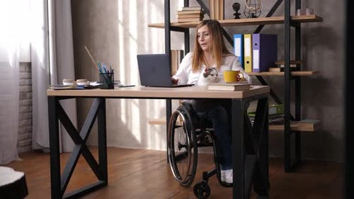Female with Impaired Mobility Working in Office