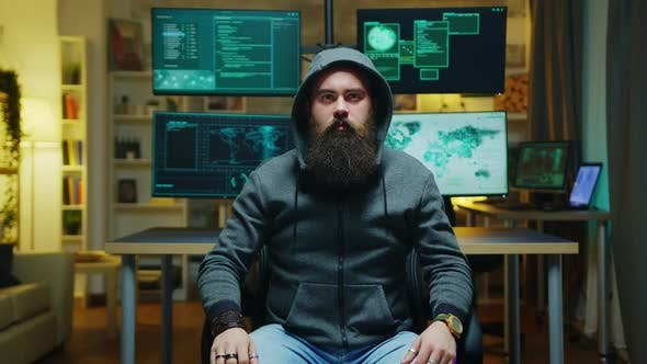 Thumbnail for Bearded Hacker Wearing a Hoodie Using Augmented Technology