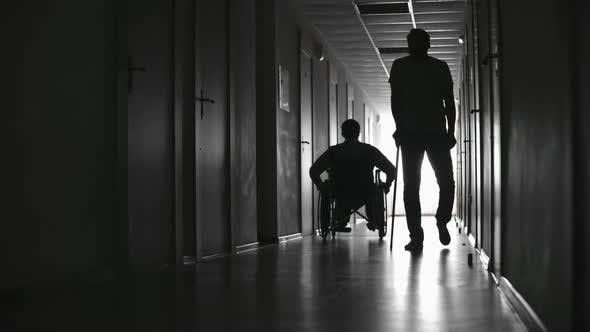 Thumbnail for Silhouettes of Patients in Hospital Hallway