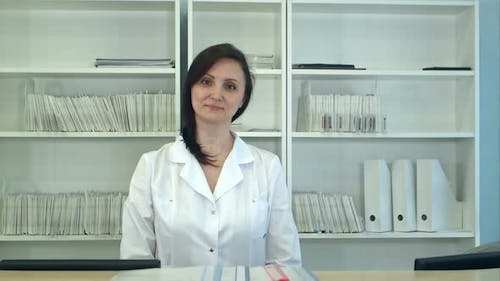 Female Hospital Receptionist Looking at Camera