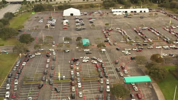 People In Cars Waiting For Covid 19 Vaccine Shot Miami Fl Aerial Pov