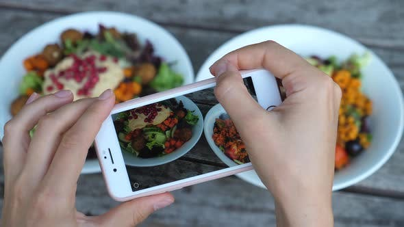 Thumbnail for Close Up Of Hands Taking Photos Of Food In Cafe, Focus On Salad Bowls In Smartphone Screen