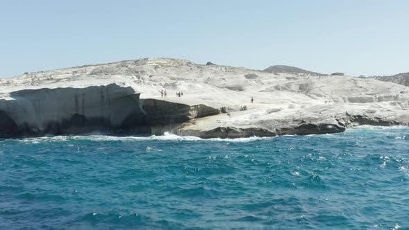 Aerial View of Sarakiniko Beach with Waves Crashing Into Rocks in Milos, Greece