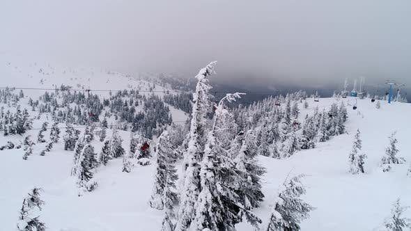 Fly over people on a ski lift