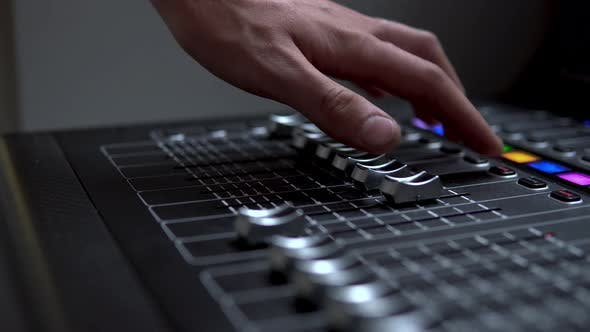 Thumbnail for Man Works on a Professional Electronic Audio Mixer. A Control Panel for Tuning Sound Channels