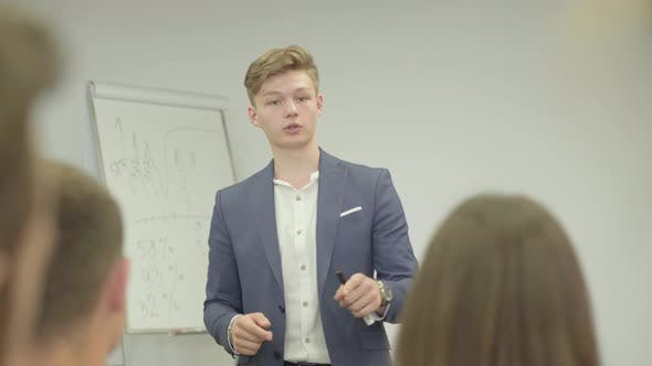 Thumbnail for Confident Young Confident Businessman Presenting New Project To Partners with Flip Chart