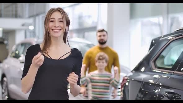 Thumbnail for Young Beautiful Caucasian Woman Bragging Car Keys and Smiling